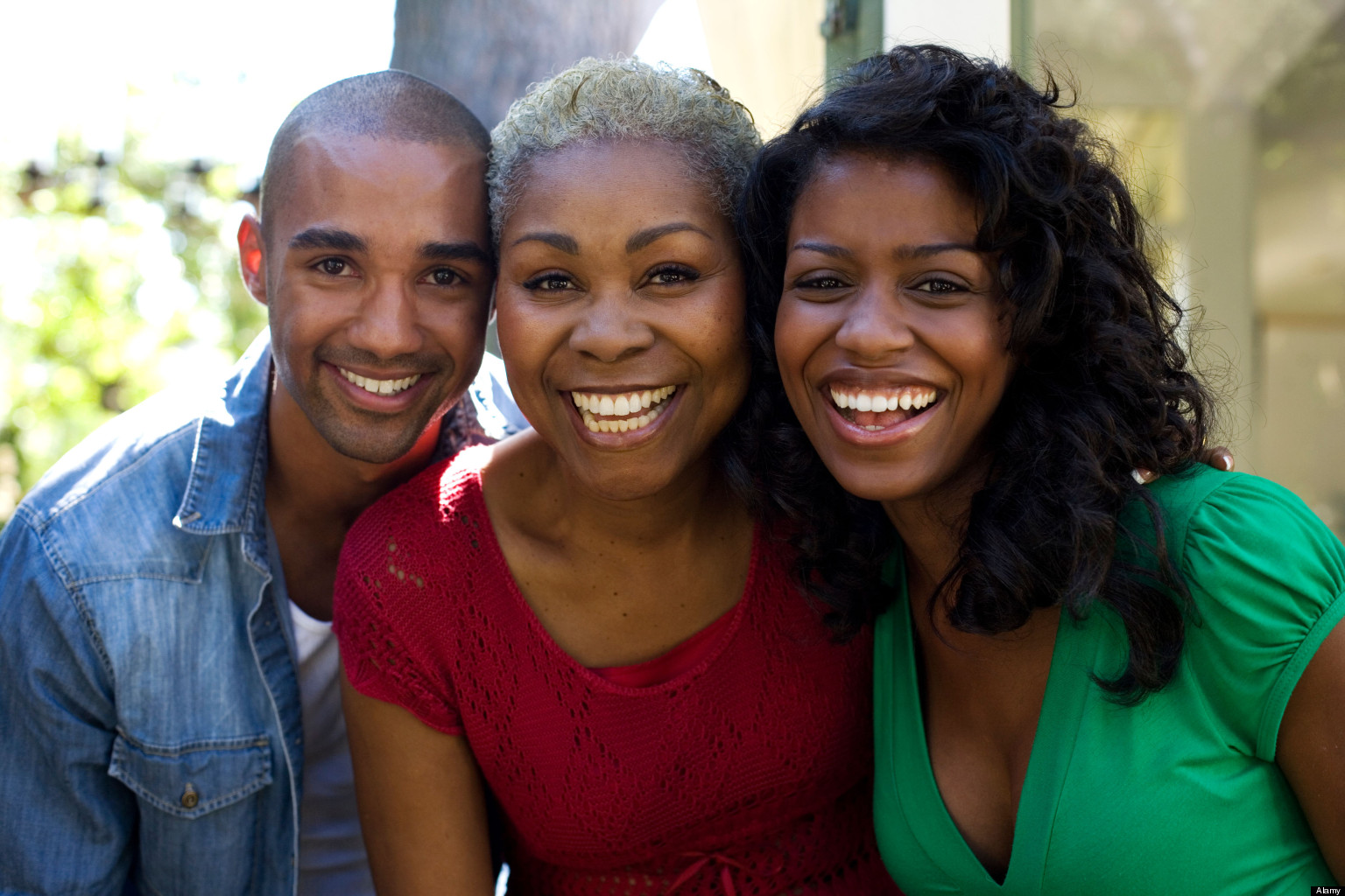 Couple and woman smiling outdoors. Image shot 2007. Exact date unknown.